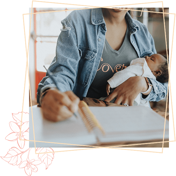 Writing a journal and holding baby